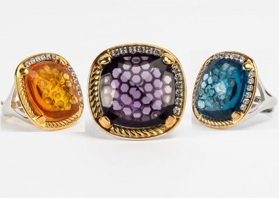 Ring with diamonds and colored stone